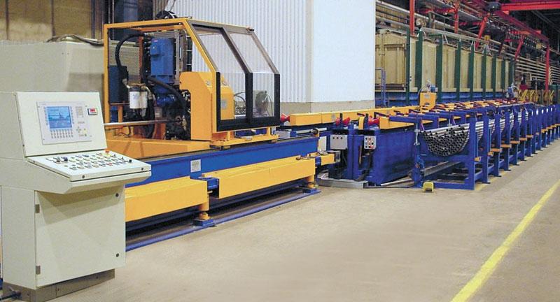 Impianto di taglio a doppia lama per tubi di grandi diametri.